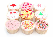 Cupcakes. Some delicious home made cup cakes on white Royalty Free Stock Images