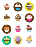 Cupcakes. Vector illustration of 12 different cupcakes with chocolate, strawberry, vanilla and fancy toppings Royalty Free Stock Image