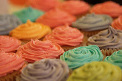 Cupcakes. Colorful cupcakes in lane in different colors, ready for additional decoration and birthday party Stock Image
