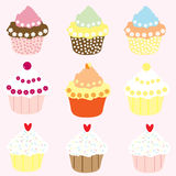 Cupcakes. Selection of 9 pretty cup cakes on a pink background, vector Royalty Free Stock Image