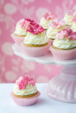 Cupcakes. Pink flower cupcakes on a cakestand Stock Images