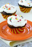 Cupcakes. A lot of cupcakes with a cream to yellow napkin Royalty Free Stock Photo