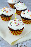 Cupcakes. A lot of cupcakes with a cream to yellow napkin royalty free stock photos