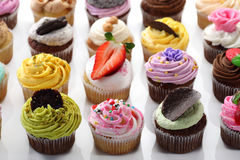 Cupcakes. Colorful assortment of cupcakes on white Royalty Free Stock Photos