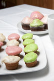 Cupcakes. Colorful baked cupcakes in a table setting Royalty Free Stock Images