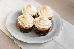 Cupcakes. Delicious wedding cupcakes decorated with macadamia nuts Royalty Free Stock Photos