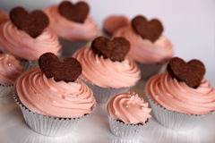 Cupcakes. Chocolate cupcakes in silver lining with chocolate hearts Royalty Free Stock Photo