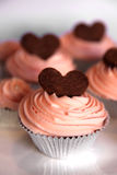 Cupcakes. Chocolate cupcakes in silver lining with chocolate hearts Royalty Free Stock Images