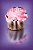 Cupcakes. Homemade chocolate muffin with pink icing and heart sprinkles stock photos