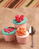 Cupcakes. Fondant and buttercream in not random setup on the table Stock Photography
