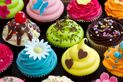 Cupcakes. Assortment of brightly decorated cupcakes Stock Photo