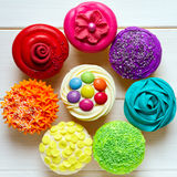 Cupcakes. Colorful cupcakes arranged in a circle Stock Image