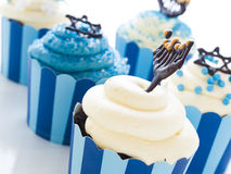 Cupcakes. Gourmet cupcakes decorated with white and blue icing for Hanukkah Stock Image