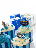 Cupcakes. Gourmet cupcakes decorated with white and blue icing for Hanukkah Royalty Free Stock Image