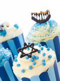Cupcakes. Gourmet cupcakes decorated with white and blue icing for Hanukkah Stock Photography