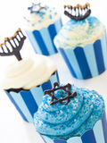Cupcakes. Gourmet cupcakes decorated with white and blue icing for Hanukkah Stock Photo