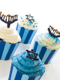 Cupcakes. Gourmet cupcakes decorated with white and blue icing for Hanukkah Royalty Free Stock Photography