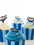 Cupcakes. Gourmet cupcakes decorated with white and blue icing for Hanukkah Royalty Free Stock Images