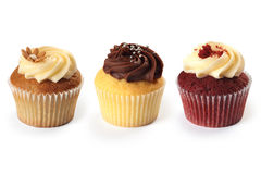 Cupcakes. Photo of three different flavored cupcakes on white background Stock Photography