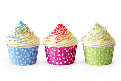Cupcakes. Colorful cupcakes against a white background Royalty Free Stock Photos