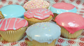 Cupcakes. Cup cakes/Muffins suitable for a birthday card or celebration card.pink and blue icing for boy or girl stock image