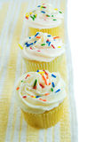 Cupcakes. Lined up on towel isolated on white Royalty Free Stock Image