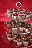 Cupcakes. Beautiful chocolate cupcakes on a 3-tier dessert tray Royalty Free Stock Photo