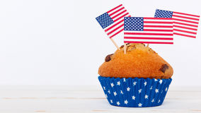 Cupcakes with american flag on white background. Cute cupcakes with american flag on white background Royalty Free Stock Photography