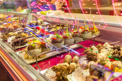 Patisserie at Dam in evening Amsterdam. Evening Dam at Amsterdam and the candy and the sweetness and the cupcakes and patisserie royalty free stock image