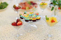 Cupcakes ans Fruits Stock Photos