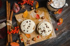 Cupcakes with autumn decorations on the rustic wooden background. Shallow depth of field. Stock Photo