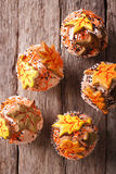 Cupcakes with autumn leaves close up. Vertical top view. Delicious cupcakes with autumn leaves close up on the table. vertical view from above Stock Image