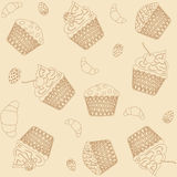 Cupcakes background. Pattern, seamless teksura; the background; croissants and muffins with strawberries Stock Photos