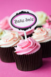 Cupcakes for a bake sale. Bake sale cupcakes against pink Royalty Free Stock Images