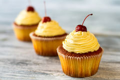 Cupcakes with beige frosting. Royalty Free Stock Photo