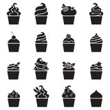 Cupcakes black icons set in flat style. Royalty Free Stock Image