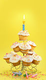Cupcakes with blue candle on yellow Royalty Free Stock Image