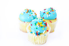 Cupcakes with Blue Frosting and Sprinkles Stock Photography