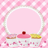 Cupcakes and border on pink gingham. Cupcakes on a decortive border with gingham background Royalty Free Stock Photo
