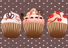 Cupcakes on the brown background Royalty Free Stock Photo