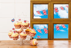 Cupcakes With Bunting. Cupcakes on stand with union flag decoration and bunting Royalty Free Stock Image
