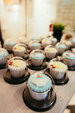 Cupcakes on cafe table Stock Images