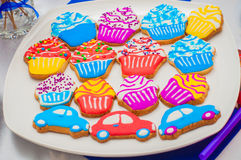 Cupcakes, cakes and holiday cookies. In the form of machines for a children's holiday. Festive treats for children's parties Royalty Free Stock Photos