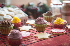 Cupcakes, cakes, sweets and candies for Christmas. In a table stock image