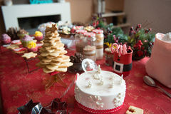 Cupcakes, cakes, sweets and candies for Christmas. In a table stock photos