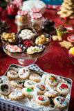 Cupcakes, cakes, sweets and candies for Christmas. In a table stock photography