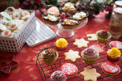 Cupcakes, cakes, sweets and candies for Christmas. In a table royalty free stock image