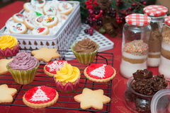 Cupcakes, cakes, sweets and candies for Christmas. In a table royalty free stock images