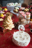 Cupcakes, cakes, sweets and candies for Christmas. In a table stock images