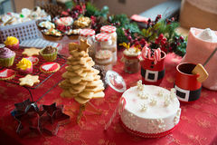 Cupcakes, cakes, sweets and candies for Christmas. In a table royalty free stock photo